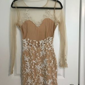 Unique sheer nude back and sleeves.